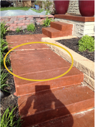 An example photo of a set of steps that require mudjacking.