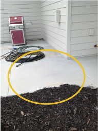 An example photo of a patio that requires mudjacking.
